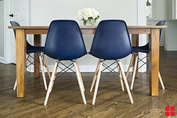 Satin navy chairs and wooden table